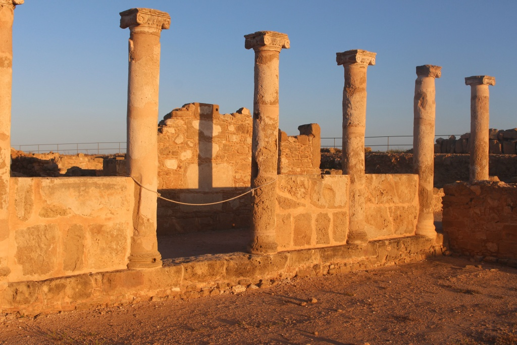 sunset over the ancient ruins at Kato Paphos Archaeological Park in Cyprus