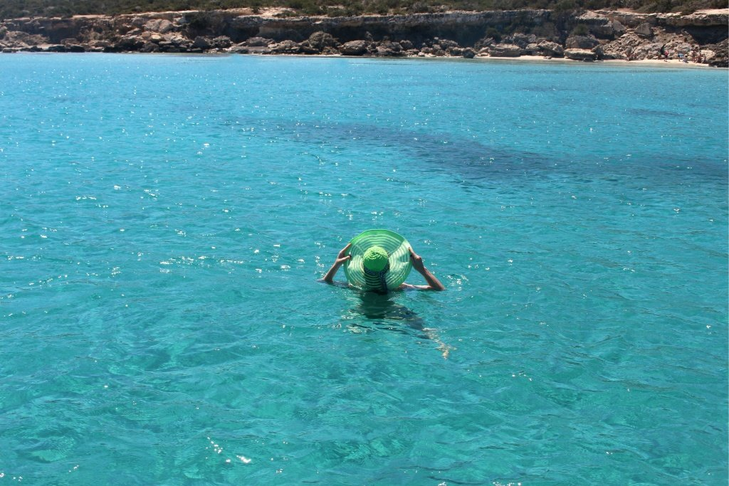 Swimming in the blue water at the paradise beach in Cyprus