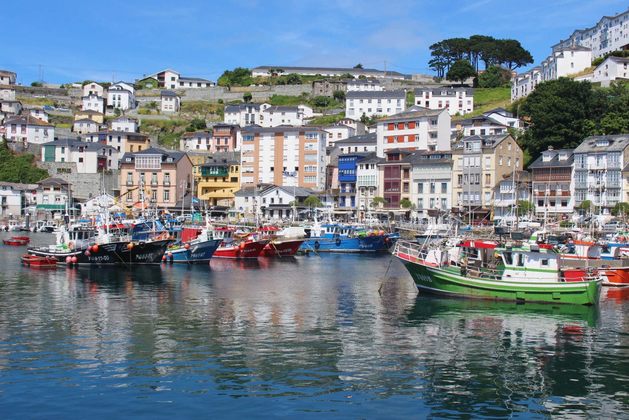 Houses and colorful boats in Luarca, Asturias, Spain