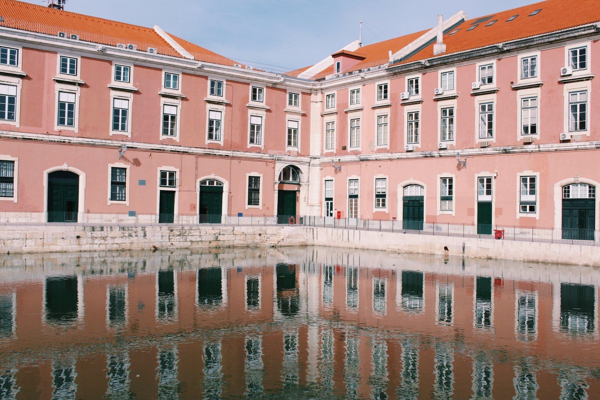 Building water reflection near Plaza do Comercio in Lisbon, Portugal