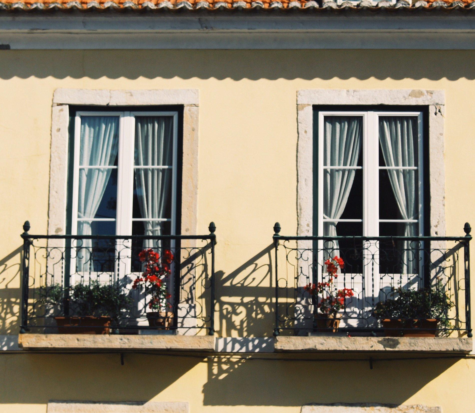 windows in Alfama District in Lisbon, Portugal