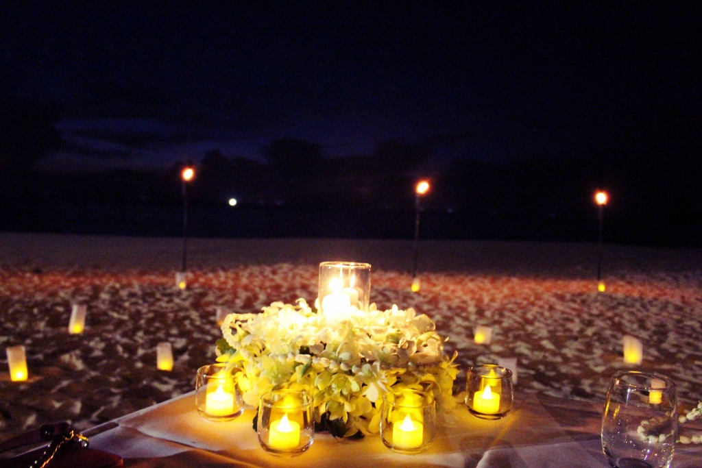 Romantic dinner with candles for couples  at the beach in Thailand